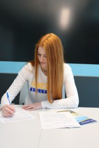 Tori Dauvin signs her Thunderwolves women's volleyball commitment papers